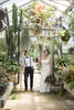 Lesbain wedding couple in greenhouse at Deep Cut Gardens