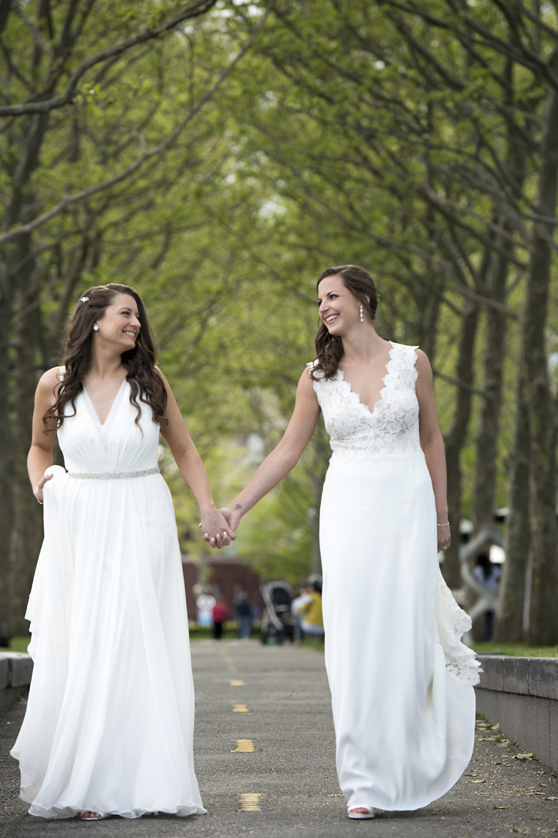 brides posing for portraits in Hoboken before their wedding celebration at Kolo Klub