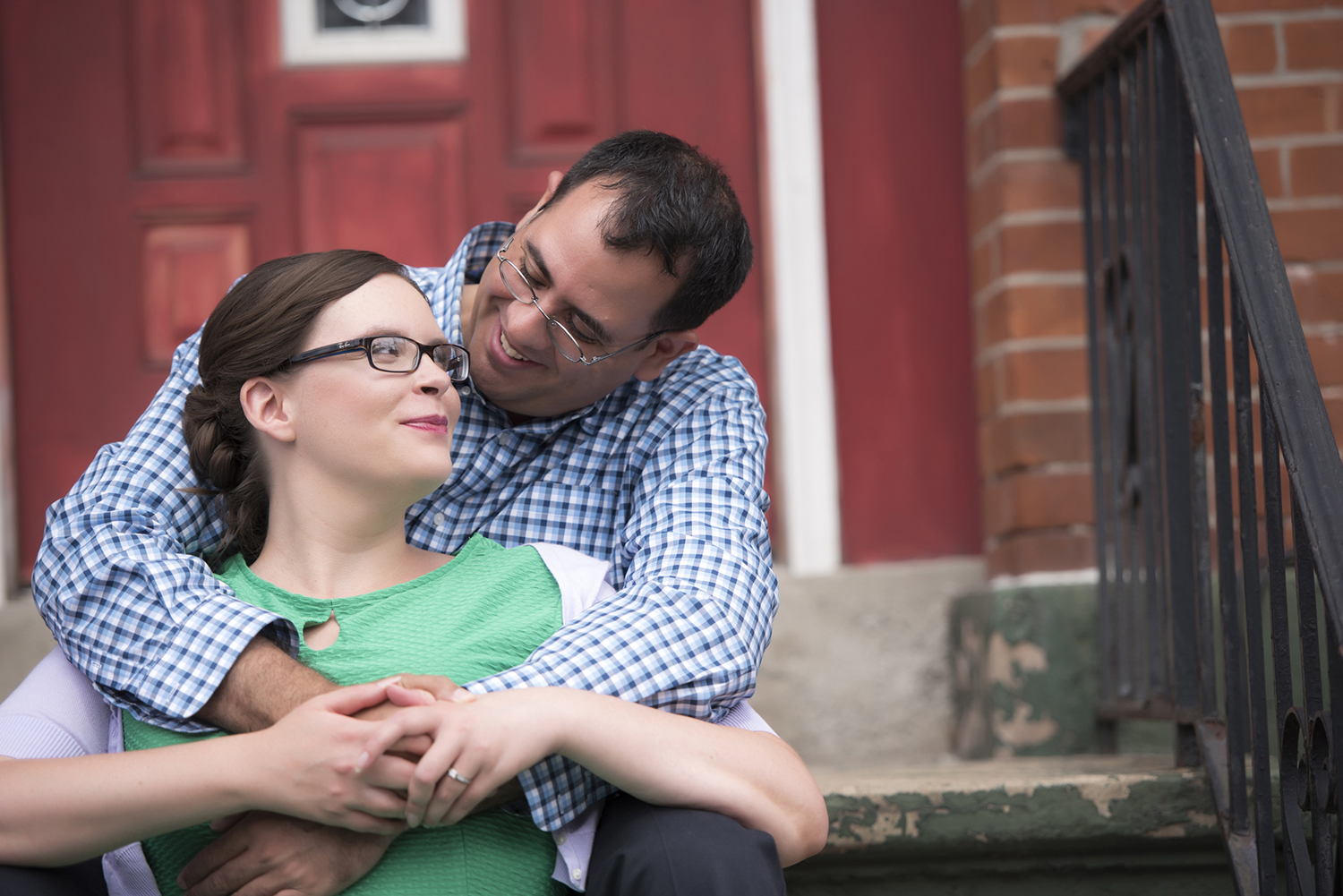 engaged couple in downtown Jersey City during their engagement session. Jersey City wedding photographers