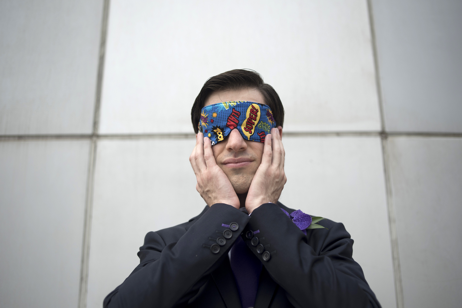 groom hiding his face before seeing bride for the first time on their wedding day at Hyatt Regency in Jersey City