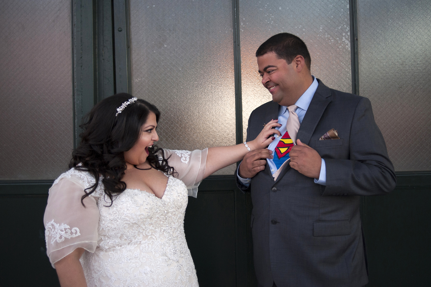 a touch of superman on their wedding day during photos in Liberty State Park. Jersey City wedding photographers