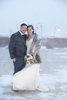 Blizzard wedding couple poses outside during winter wedding at the Hyatt Regency Jersey City. Jersey City Wedding Photographers
