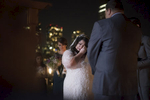 bride tears up during her wedding ceremony at Liberty House in Jersey City. Jersey City wedding photographers