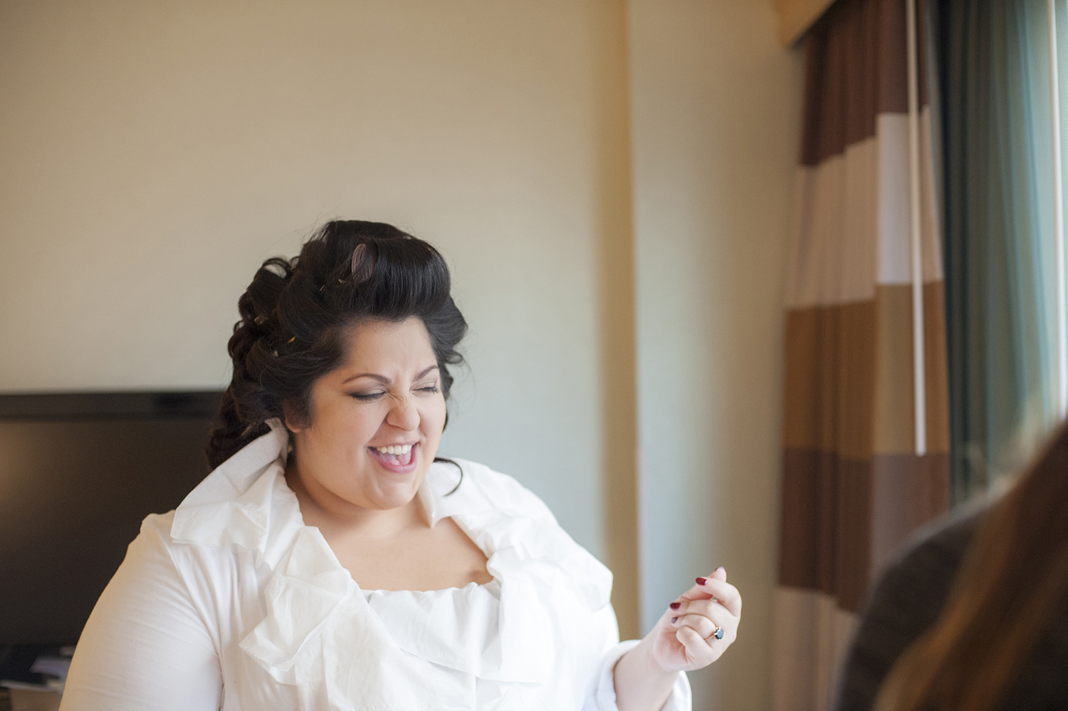 bride belts out a song while getting ready on her wedding day. Jersey City wedding photographers