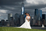 bride and groom posing for a portrait againt the NYC skyline before their micowedding ceremony at Liberty House in Jersey City. Jersey City wedding photographer
