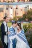 couple is wrapped in a tallis during their Jewish wedding at Liberty House in Jersey City. Jersey City wedding photographer