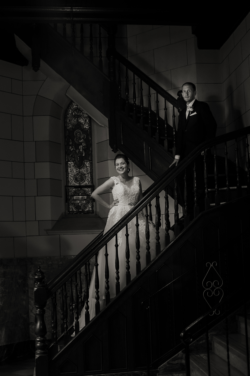 bride and groom pose for a portrait in Jersey City church after their wedding ceremony. Jersey City wedding photographer