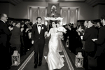 bride and groom dance down the aisle after the conclussion of their wedding ceremony at Temple Emanu-El in Closter