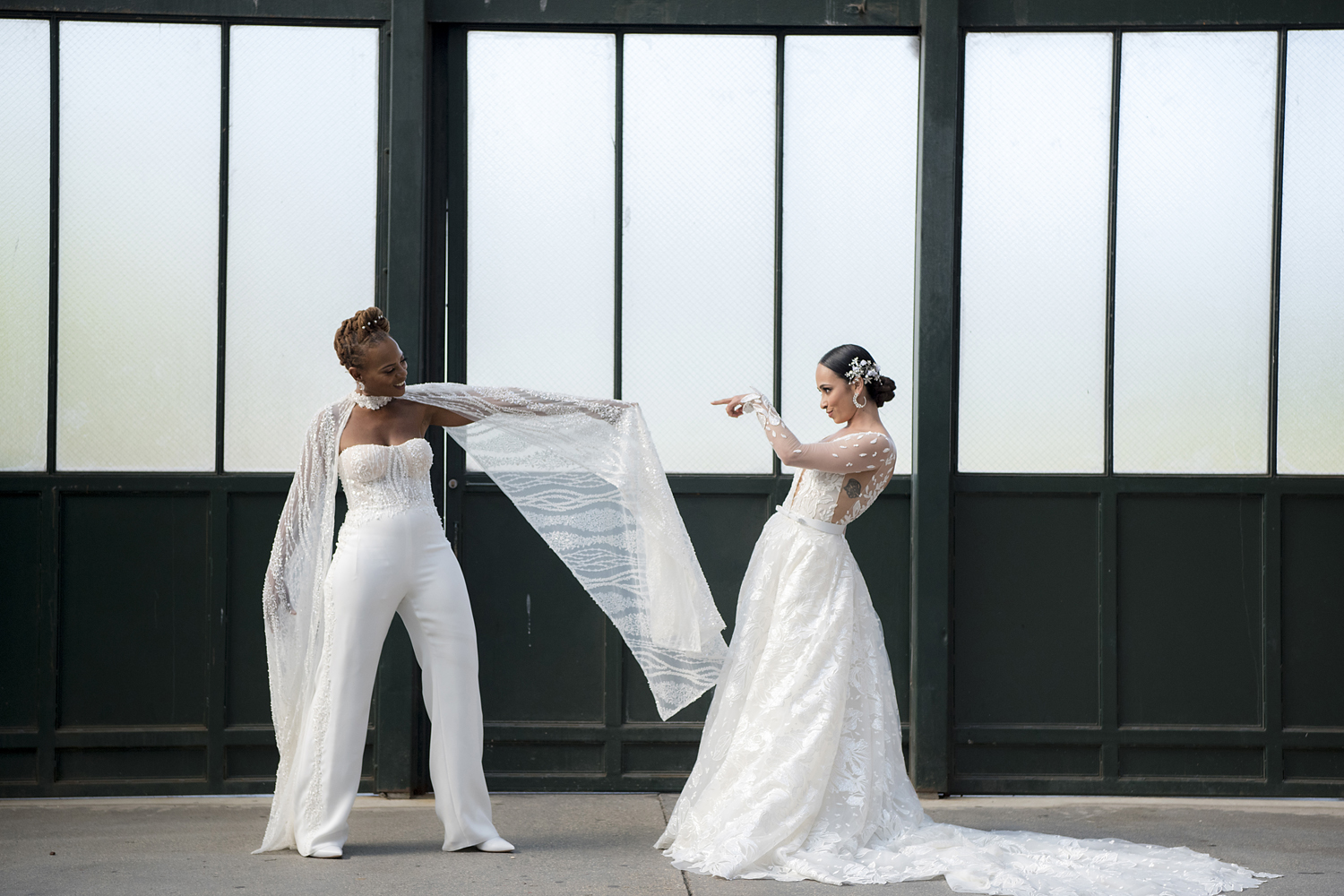 Brides pose for portraits at Liberty State Park before their Liberty House wedding in Jersey City
