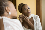 Bride getting ready before her wedding at Liberty House in Jersey City. Jersey City wedding photographer