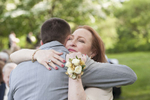 mother of the groom gives her son a hug after walking down the aisle at his wedding at Rutgers Gardens. NJ wedding photographers