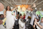 bride and groom during hora being lifted in chairs above their guests at Rutgers Gardens. NJ wedding photographer