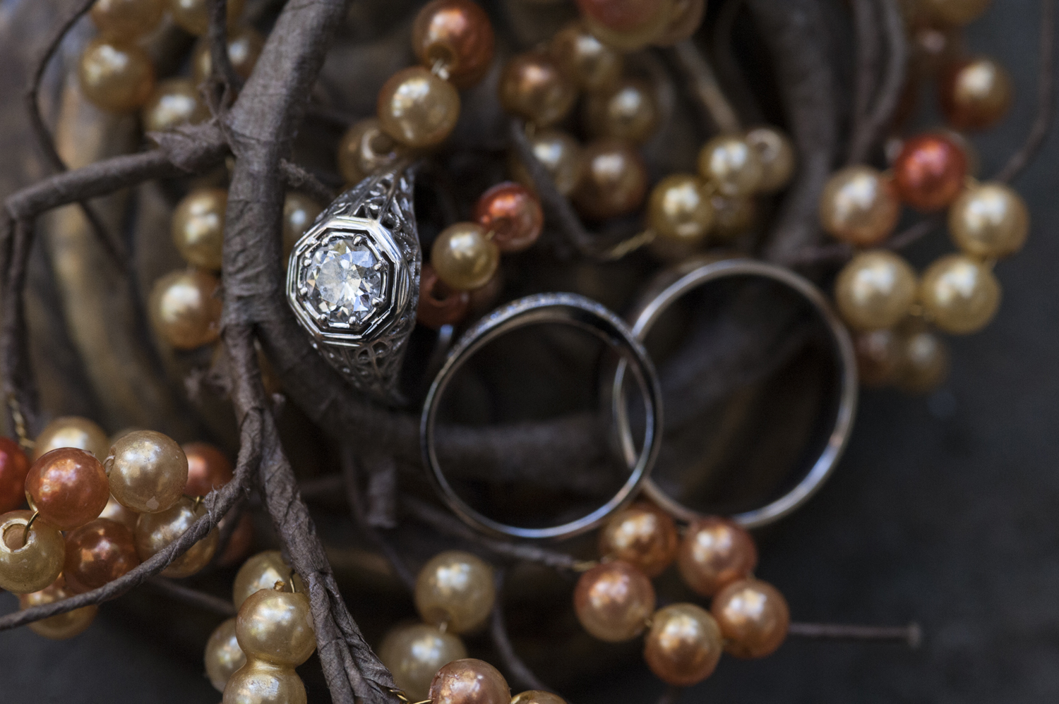detail of wedding rings against ring box and fall decor. NJ wedding photographer