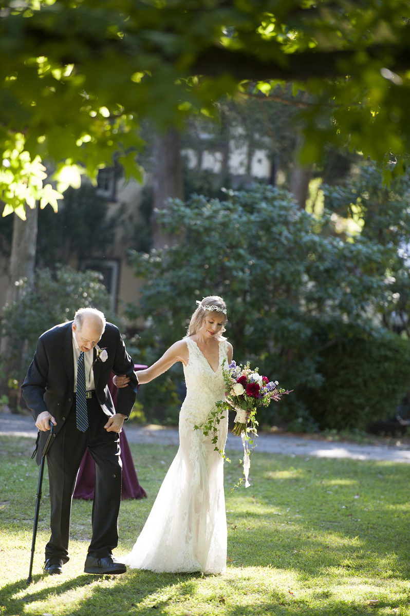 bride leads her father to the wedding ceremony at Trebor Garth Estate. NJ wedding photographer