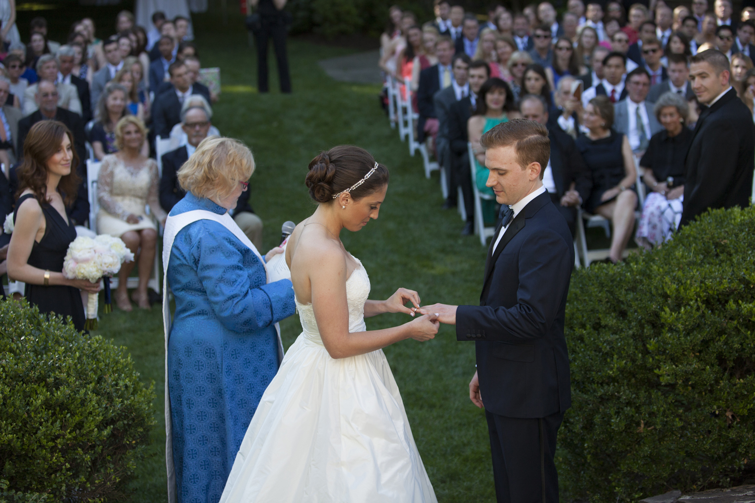 bride and groom exchange rings during their backyard wedding ceremony in Morristown, New Jersey