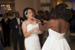 brides dancing and celebrating their wedding. Lesbian wedding