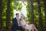 bride and groom sit amongst the greenery at Elizabeth Park. NYC wedding photographer