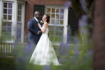 Biracial bride and groom laughing on their wedding day at Yale Divinity School in New Haven, CT.