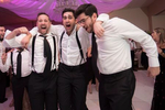 groom and his friends dancing at the reception of his  Jewish wedding at Temple Emanu-El in Closter. NJ wedding photographer