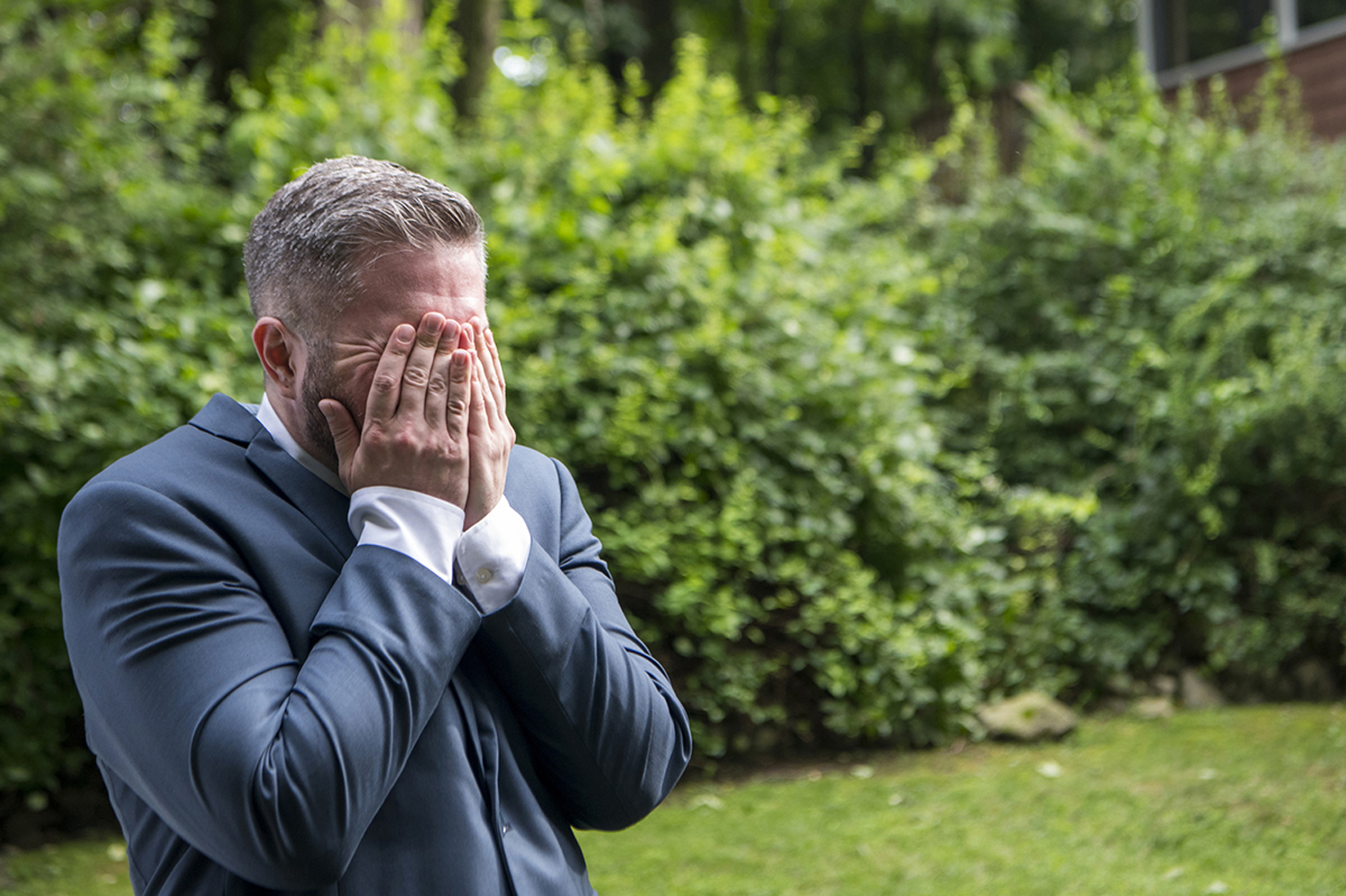 Groom's reaction to seeing his bride walk down the aisle. New York backyard wedding.