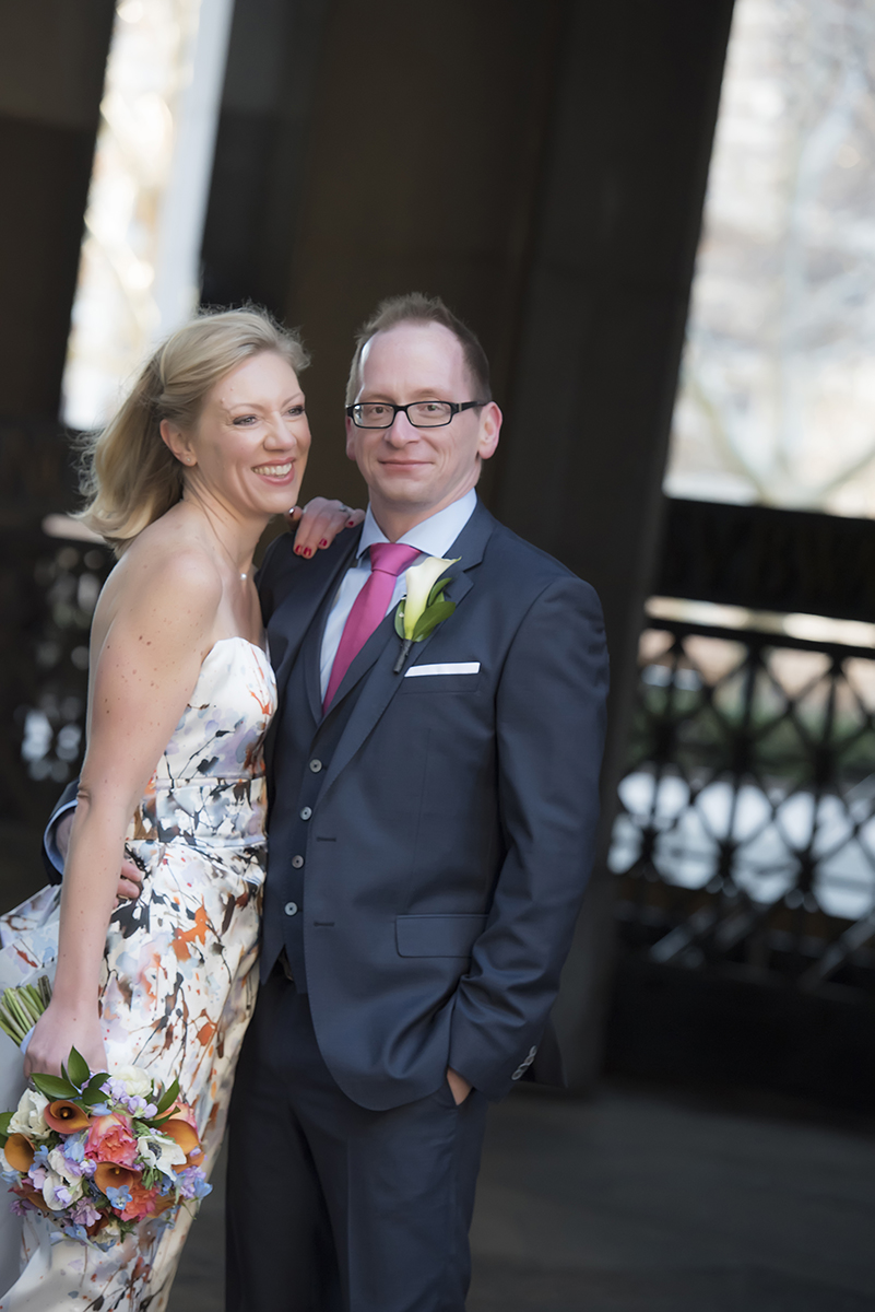 Floral-clad wedding dress bride with her groom at NYC City Hall