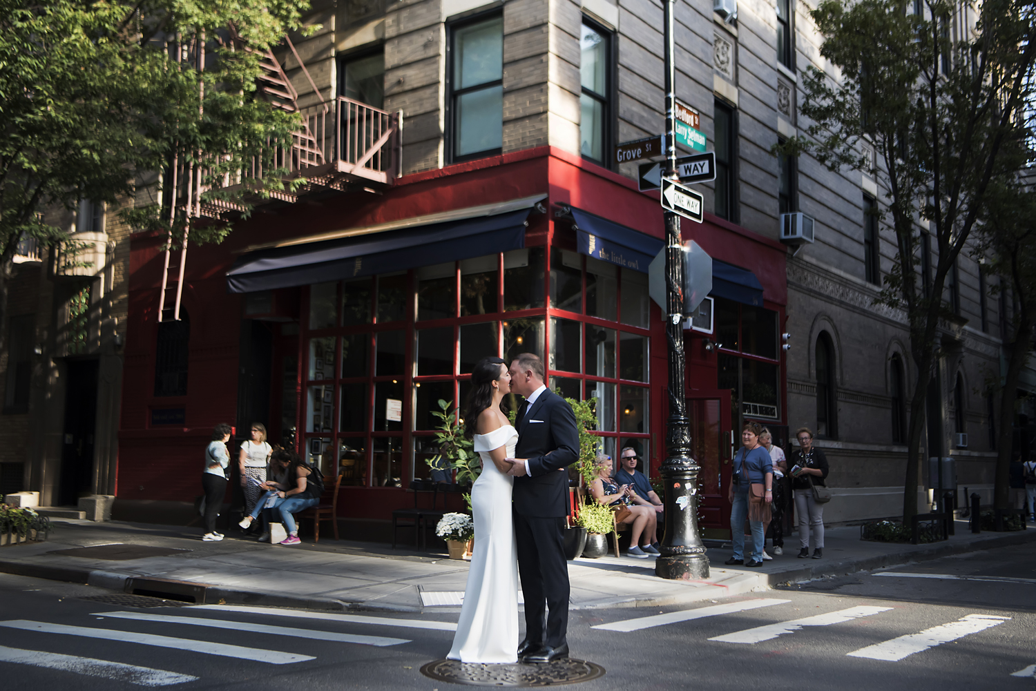 bride and groom in NYC on their wedding day. NYC wedding photographers