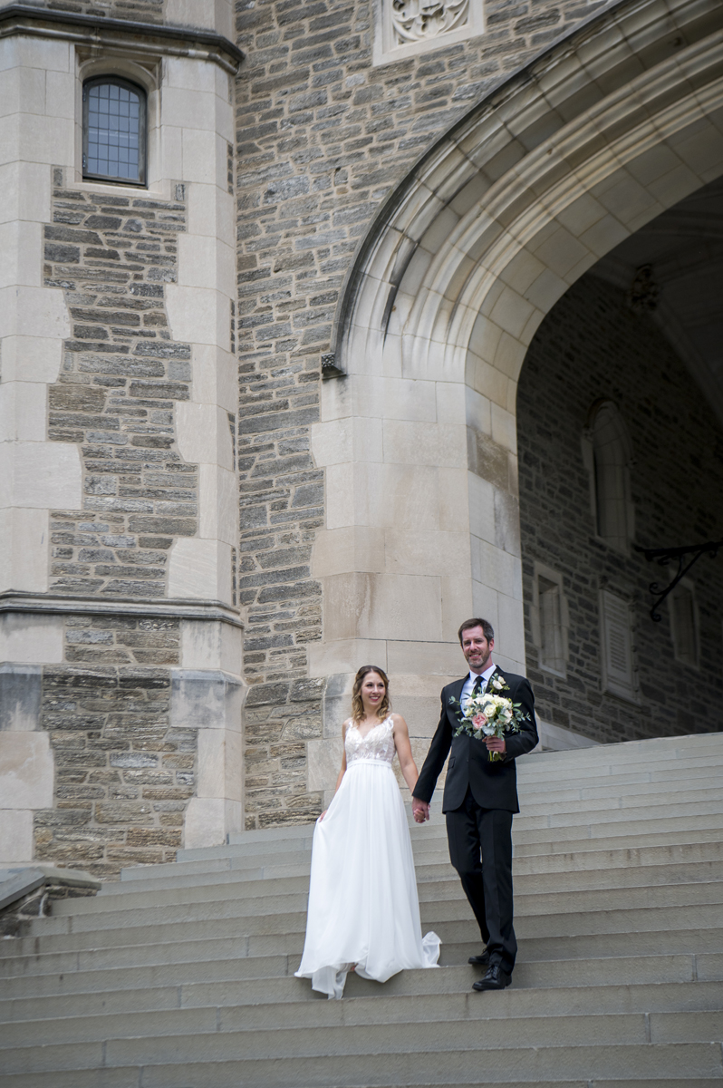wedding couple walks to their ceremony site for their microwedding at Princeton University. Princeton wedding photographer