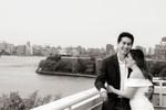 portrait of bride and groom on their wedding day on rooftop in Astoria, Queens. Queens wedding photogrpher