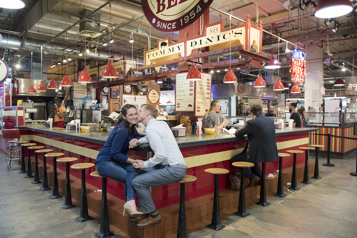 Engaged couple at Reading Terminal Market for their Philadelphia engagement session.