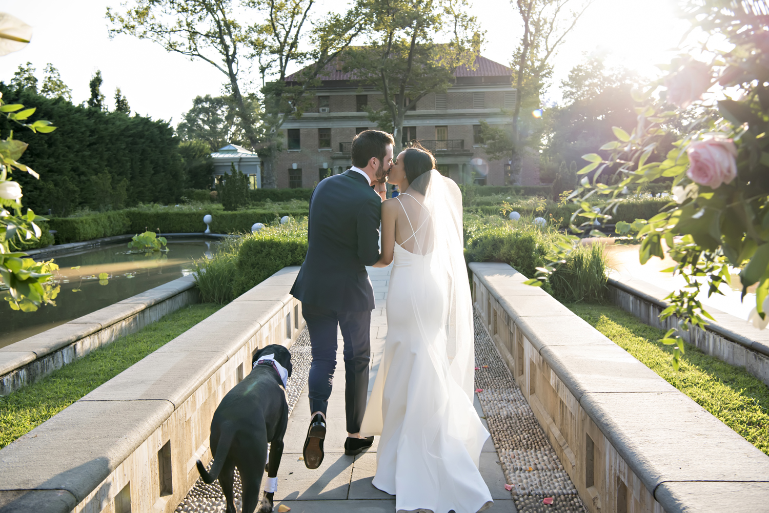 bride, groom, and their dog at the conclusion of their wedding ceremony at Celebrate at Snug Harbor.