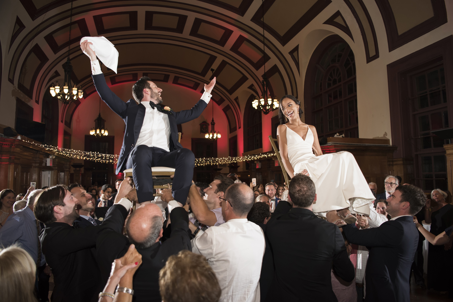 Bride and groom during the hora on their wedding day at Celebrate Snug Harbor in Staten Island