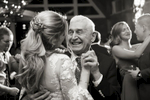 Grandfather dances with bride at The Lodge at Stirling Ridge