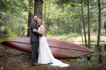 Bride and groom in front of canoe at Magnolia Streamside Resort
