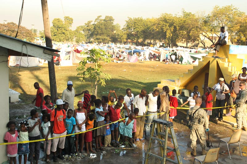 On the morning that the field hospital was ready, hundreds of people already lined up outside the gates for a chance to be given medical treatment or resources or both. Thousands of displaced Haitians remained in a {quote}Tent City{quote} immediatly adjacent to the hospital.
