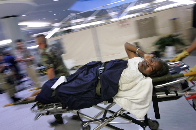 The Louis Armstrong New Orleans Airport became a large-scale repository for those evacuated from hurricane-destroyed areas. Evacuees were airlifted from various locations, including hospitals and nursing homes, to the airport, where they were triaged and sorted according to immediate needs.