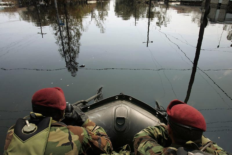 The 82nd Airborne Division 3rd Platoon Charlie Company 307 Engineer Batallion conducted search, rescue and recovery missions aboard Zodiac boats in the severely flooded 3rd precinct of New Orleans on Saturday, September 10, 2005. These men have oars leading the Zodiac as to look out for cars under the flood waters.