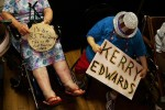 Florida residents sitting in the handicapped area show their support for Senators Kerry and Edwards through signage and props during a late-night rally in a packed Coliseum in St. Petersburg, Florida on July 7, 2004.