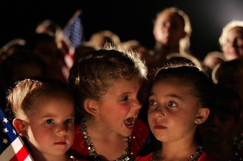These young Kerry supporters from Zanesville, Ohio wore their sparkly dance costumes to a late-night campaign event on July 31, 2004. The eldest had opinions about how best to stand.