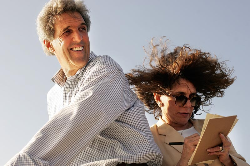 Senator John Kerry shielded his wife, Teresa Heinz Kerry, from the 40 MPH wind on the Lake Express, a ferry that took them from Michigan to Wisconsin over Lake Michigan. Teresa was writing a speech on the windy deck, and persisted despite the winds.