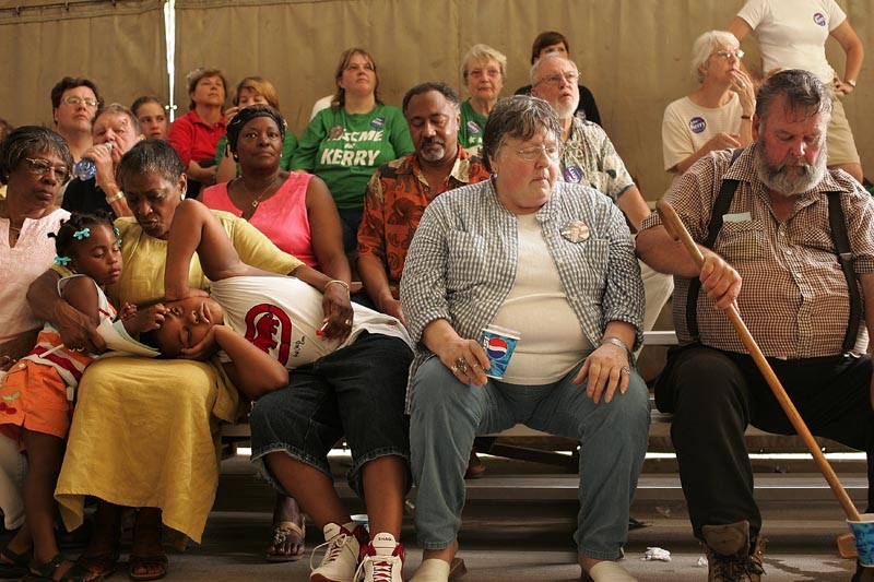 The audience during a Beloit, Wisconsin campaign event battled boredom and 100 degree heat while waiting for Kerry to speak during a town meeting on August 3, 2004.