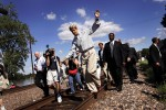 Senator Kerry balanced on the railroad rails while walking to shake hands with supporters during a campaign stop in Washington, Missouri.