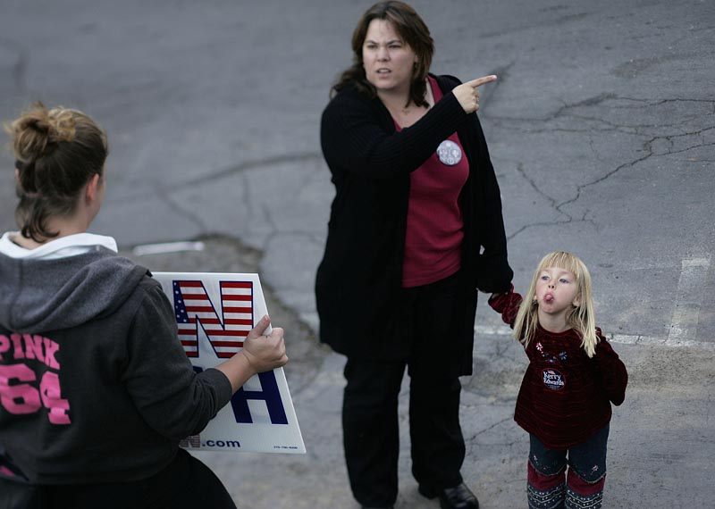 A young Kerry supporter made her feelings known to a Bush supporter outside a campaign rally in Reno, Nevada on October 22, 2004.