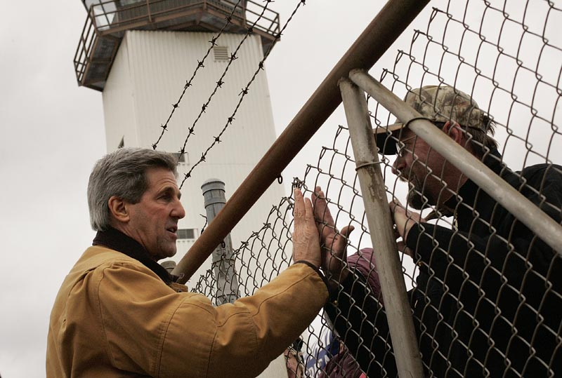 Senator John Kerry said a quick hello and thank-you to supporters who stood out in the cold wind waiting for the arrival of the campaign motorcade at the Outgamie County Regional Airport in Appleton, Wisconsin.