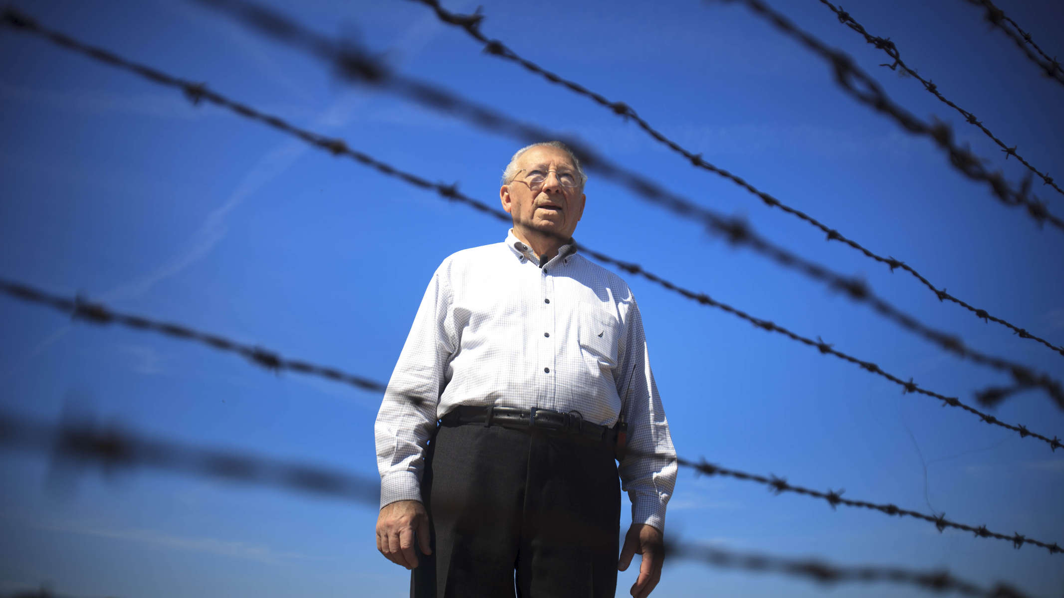 Oświęcim, Poland - 4/27/2012 -  On April 27, Israel {quote}Izzy{quote} Arbeiter, 87, pauses during a final visit to the Auschwitz-Birkenau concentration camp, where he was a prisoner in 1944.  An estimated 1.1 million of the 1.3 million people who came through the camp were killed, mostly in gas chambers, although Izzy also remembers prisoners throwing themselves on the fences to die, rather than wait for the Nazis to kill them. Story by David Filipov/Globe Staff. Dina Rudick/Globe Staff