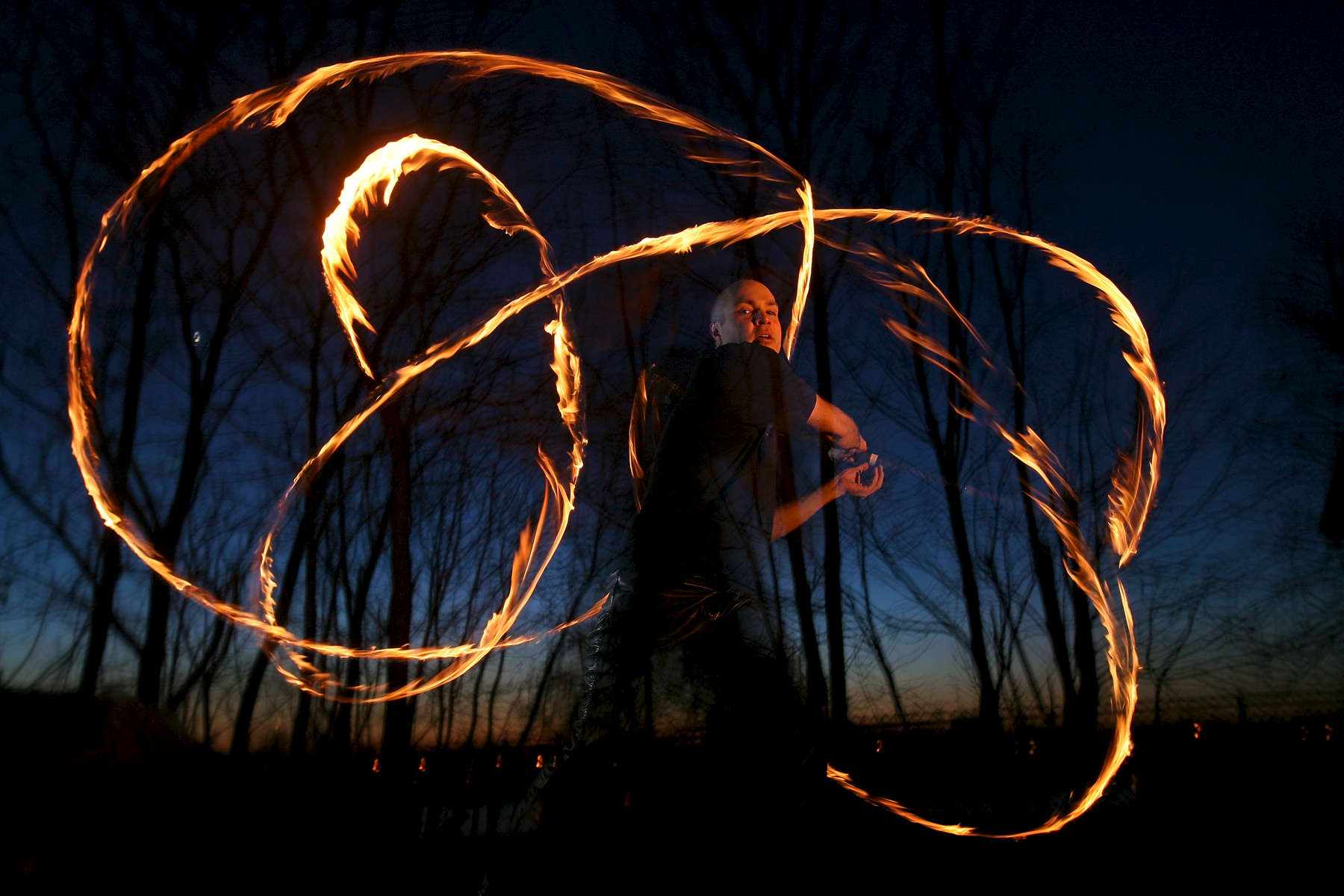 Salem, MA  03/11/2007 Chad Bennett, cq, is a poi (fire spinner) in Salem, MA. He is demonstrating various fire spinning techniques. Every summer for the past two years, Chad has been hosting the Wildfire Festival, a bi-annual. 3-day intensive training camp for New England fire performers, belly dancers and drum makers. Story by Amy Farnsworth.  Dina Rudick/Globe Staff.