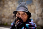 2/25/11 - Cuenca, Ecuador - Maria Avelina Cela, the mother of murder victim Maria Avelina Palaguachi-Cela, waited on a curb outside the Cuenca morgue for her daughter and grandson's bodies to be released.