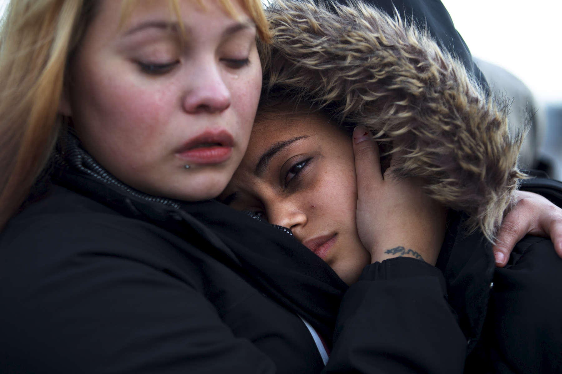1/01/2014 - East Boston, MA - Andrew McArdle Bridge - Stephanie Ruiz, cq, left, comforted Nancy Garcia, cq, whose mother, Aura Garcia, was crushed to death on Tuesday, December 31, 2013 by the Andrew McArdle bridge in East Boston. {quote}She was basically like my mother,{quote} said Ruiz. {quote}What we want is justice,{quote} added Ruiz. Topic: 02bridge. Story by Meghan Irons/Globe Staff. Dina Rudick/Globe Staff