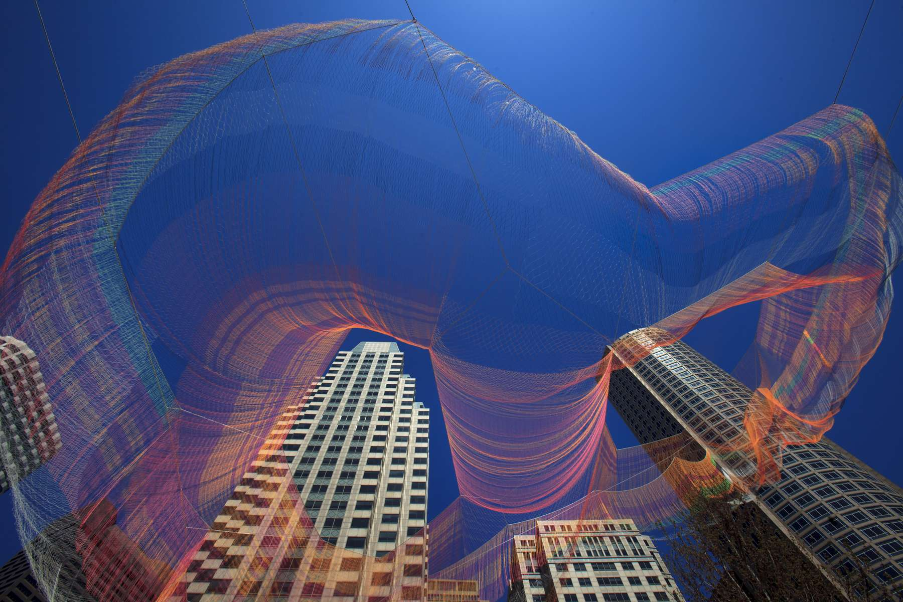 5/03/2015 - Boston, MA -  A new aerial sculpture by artist Janet Echelman was suspended above the Rose Kennedy Greenway on Sunday, May 3, 2015. Topic: EchelmanGreenway(4). Story by Malcolm Gay/Globe Staff. Photo by Dina Rudick/Globe Staff.