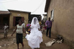 Christiana Etim walks through her neighborhood in Jos, Central Nigeria, on her way to the church to get married.