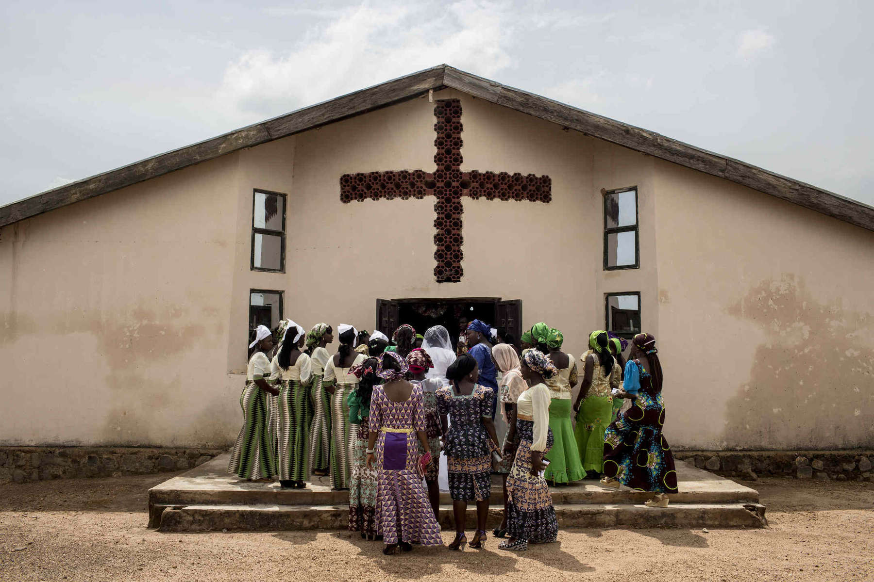 Guests gather outside a church in Jos, central Nigeria, just before a wedding.